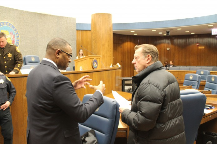 Chicago Crusader CS COMM. RICHARD BOYKIN TALKING TO FATHER MICHAEL L. PFLEGER AFTER FIRST TASK FORCE MEETING ON GUN VIOLENCE 2.16.163 696x464