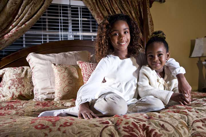 bigstock-Two-little-sisters-sitting-720480