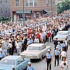 Marchers advocating for housing rights for blacks in Chicago are seperated by police from white protesters during Martin Luther King Jr.'s visit in August 1966