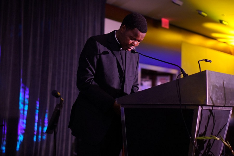 100th Anniversary Gala | Father Thulani prays | photo by Mack Julion