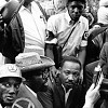 Martin Luther King Jr. at the rally at Marquette Park where he was struck by a stone | August 1966