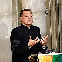 Portrait of Rev Pfleger speaking at Historic Riverside Church NYC 953px by 720px