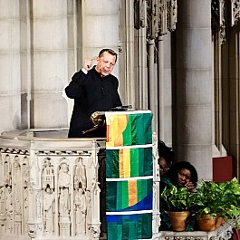 Portrait of Rev Pfleger speaking at Historic Riverside Church NYC 886px by 800px