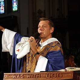 Portrait of Rev Pfleger preaching at St. Sabina 800px by 534px