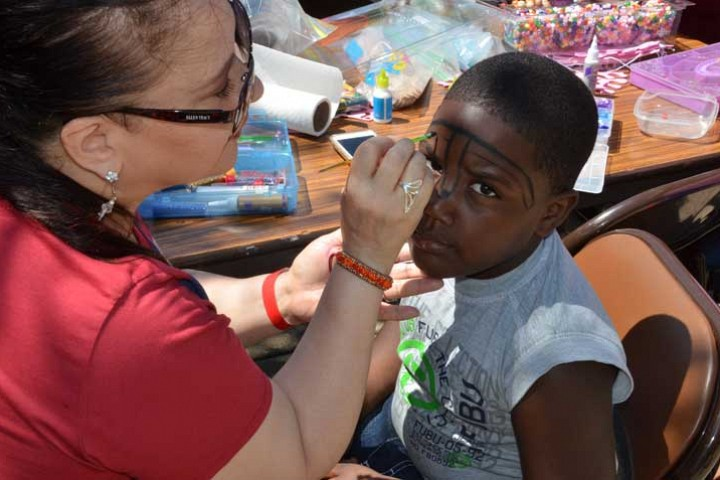 Day of Service on July.9.2016. Communications Ministry hosts art projects and face painting for children in Renaissance Park at 79th and Throop_ photo by Michael Gunn
